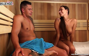Downcast tanned nympho with juicy knockers Mea Melone gives BJ close by the sauna