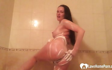 Brunette washes her pussy and moans in pleasure