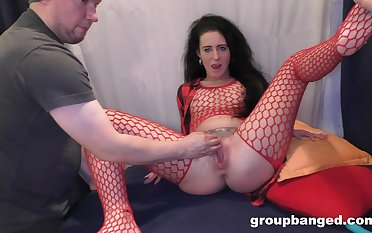 Nasty mature in red fishnet gets fucked by two younger studs