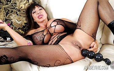 Tanned whorish MILF Ava Devine has some anal beads be incumbent on her solo show