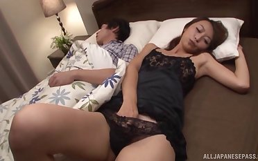 Asian babe gets her hairy cunt drilled contiguous near her sleeping hubby