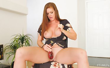 Redhead wifey Ivy drops her panties to play on every side her vibrator