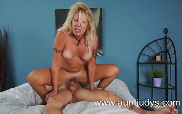 Mature blonde and her young lover enjoy their fuck