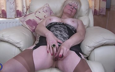 Buxom amateur mature British granny Cindy S. masturbates in pantyhose