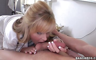 Doctor Darcy Tyler gets oiled up and rides a huge cock