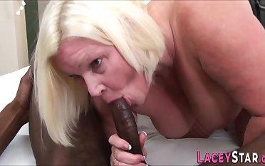 Granny fucks get pleasure from a pro in the matter of a big black male stick - interracial sex