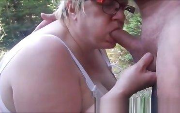 Slut granny having fun open-air
