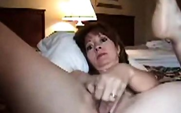 Mature woman masturbating on camera
