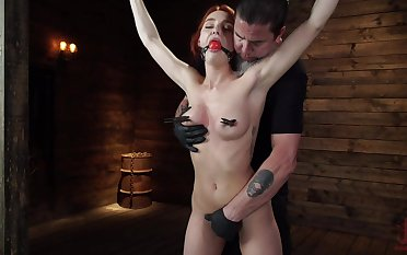 Smiling redhead model Lacey Lennon gets turned dedicate oneself to bondage